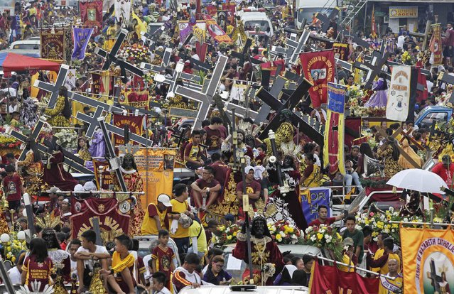 Devotees with replica statues of the Black Nazarene participate in a procession in Manila January 7, 2015. (Photo by Romeo Ranoco/Reuters)