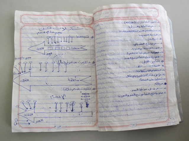 A notebook belonging to an al Qaeda fighter, which was found in a former militant training camp in southern Yemen in May 2014, is seen in this picture taken July 8, 2014. The left page shows diagrams depicting various types of ambushes. (Photo by Martin Dokoupil/Reuters)