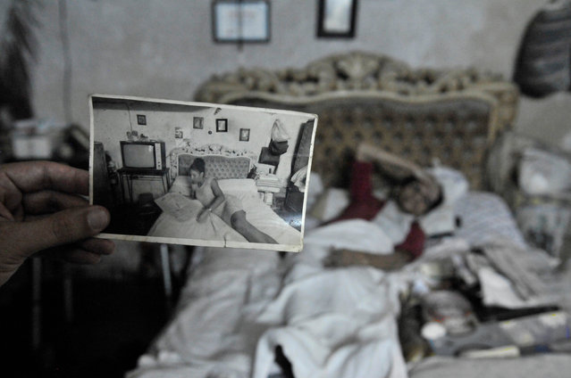 """Looking Back in Time"". While walking down the street in Old Havana, I was invited into this elderly woman's home. She was lying in bed and told me she wasn't feeling well. She asked if I had any aspirin which I did have in my purse. As I bent over to give it to her, I noticed this photograph on the nightstand beside her bed. It was taken of her many years before lying in the very same bed. I thought this was very cool. (Photo and caption by Terri Gross/National Geographic Traveler Photo Contest)"