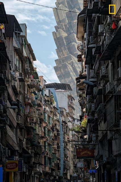 The Invasion. A quiet street in Macau. Modernization around is quickly changing the city, as documented by Paul Tsui. (Photo by Paul Tsui/National Geographic Travel Photographer of the Year Contest)