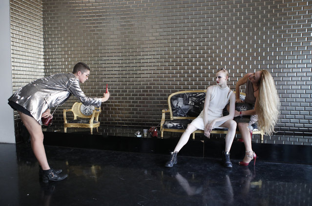 Fashion lovers take photos during Jean-Paul Gaultier Haute Couture Fall-Winter 2018/2019 fashion collection Wednesday, July 4, 2018 in Paris. (Photo by Francois Mori/AP Photo)