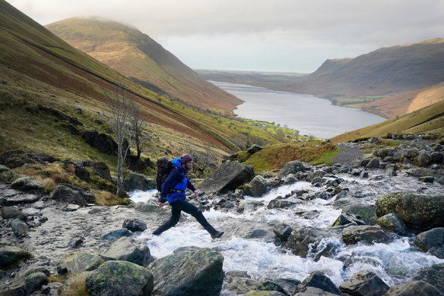 An award-wining photographer has battled freezing rain and 60mph winds to scale England's highest peak six times in 24 hours on December 20, 2020 in a bid to give a seriously ill baby a chance of a longer life. Joe Giddens, 33, picked some of the worst weather of the winter so far to attempt an epic challenge on the 3,209ft (978m) Scafell Pike to help seven-month-old Marley Powell, who has a rare genetic disorder. (Photo by Owen Humphreys/PA Images via Getty Images)