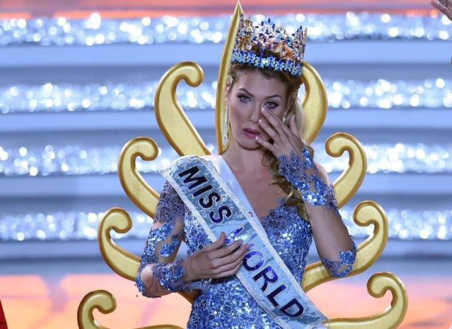 Mireia Lalaguna Rozo of Spain reacts after winning the new title at the Miss World at the Grand Final in Sanya, in southern China's Hainan province on December 19, 2015. (Photo by Johannes Eisele/AFP Photo)