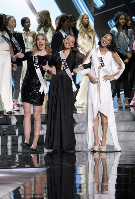 (L-R) Miss Croatia 2015 Mirta Kustan, Miss Aruba 2015 Alysha Boekhoudt and Miss Japan 2015 Ariana Miyamoto pose during rehearsals, in this handout photo provided by the Miss Universe Organization at the Planet Hollywood Resort & Casino in Las Vegas, Nevada, December 19, 2015. (Photo by Richard D. Salyer/Reuters/The Miss Universe Organization)