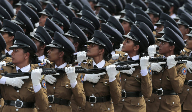 Sri Lanka's women police officers march during Independence Day celebrations in Colombo, Sri Lanka, Wednesday, February 4, 2015. Sri Lanka has failed to heal its deep ethnic divide since the end of the nation's civil war five years ago, the president acknowledged Wednesday in a major speech calling for national reconciliation. (Photo by Eranga Jayawardena/AP Photo)