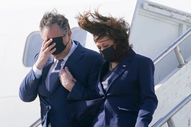 Vice President Kamala Harris and her husband Doug Emhoff, walk off Air Force Two on arrival to Los Angeles, Monday March 15, 2021. (Photo by Jacquelyn Martin/AP Photo)