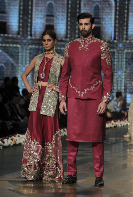 Models present creation of designer Faiza Saqlain during Bridal Couture Week 2016 in Lahore, Pakistan, Sunday, November 27, 2016. (Photo by K.M. Chaudary/AP Photo)