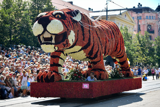 The float called Tiger is seen during the 49th Debrecen Flower Festival in Debrecen, 226 kms east of Budapest, Hungary, 20 August 2018, one of Hungary's major national holidays when Hungarians commemorate the foundation of their state and its founder King St Stephen. (Photo by Zsolt Czegledi/EPA/EFE)