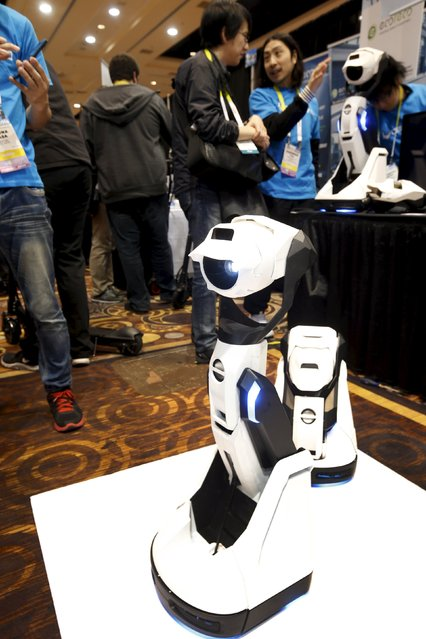 """A Tipron robot projector by Cerevo is displayed during """"CES Unveiled,"""" a preview event of the 2016 International CES trade show, in Las Vegas, Nevada January 4, 2016. The robot can move through the home by himself and display a variety of Internet content. (Photo by Steve Marcus/Reuters)"""