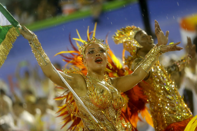 Performers from the Mocidade samba school, parade during Carnival celebrations at the Sambadrome in Rio de Janeiro, Brazil, Monday, February 16, 2015. (Photo by Silvia Izquierdo/AP Photo)