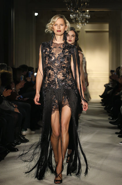 Models walk down the runway at the conclusion of the Marchesa Fall 2015 fashion show in New York, Wednesday, February 18, 2015. (Photo by Kathy Willens/AP Photo)