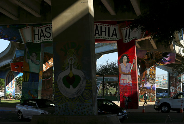 A man walks through Chicano Park situated under a bridge and highway interchange in San Diego, California, U.S., November 3, 2016. (Photo by Mike Blake/Reuters)