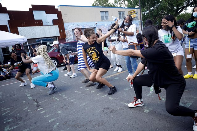 People dance at George Floyd Square on the first anniversary of George Floyd's death, in Minneapolis, Minnesota, U.S., May 25, 2021. (Photo by Nicholas Pfosi/Reuters)