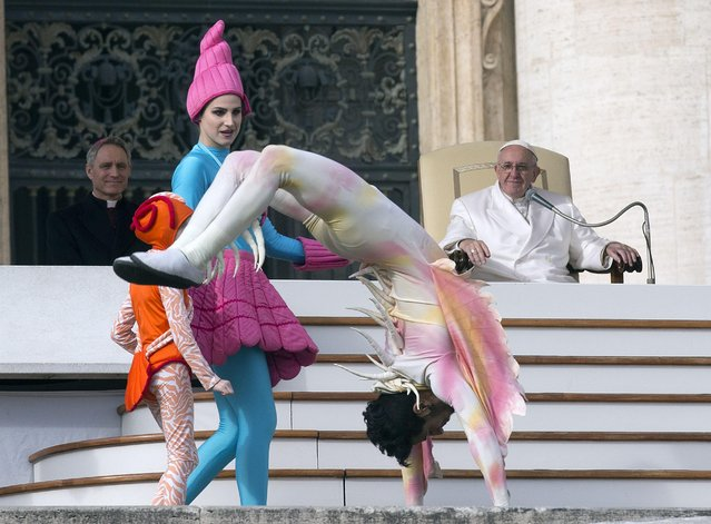 Circus artists perform for Pope Francis during his weekly general audience in St. Peter's Square, at the Vatican, Wednesday, January 27, 2016. (Photo by Andrew Medichini/AP Photo)