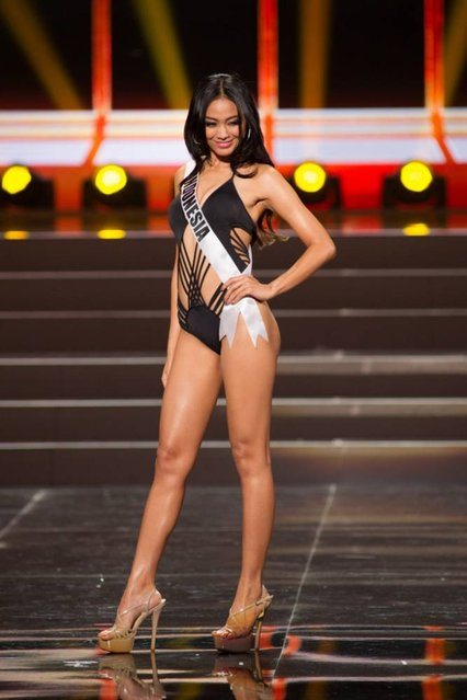 This photo provided by the Miss Universe Organization shows Whulandary, Miss Indonesia 2013, competes in the swimsuit competition during the Preliminary Competition at Crocus City Hall, Moscow, on November 5, 2013. (Photo by Darren Decker/AFP Photo)