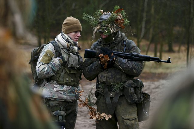Beata Noskowicz from Obrona Narodowa, a paramilitary organisation, takes part in a territorial defence training organised by paramilitary group SJS Strzelec (Shooters Association) in the forest near Minsk Mazowiecki, eastern Poland March 14, 2014. (Photo by Kacper Pempel/Reuters)