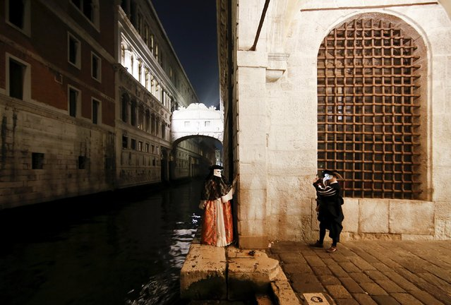 Masked revellers take pictures during the Venice Carnival, Italy January 29, 2016. (Photo by Alessandro Bianchi/Reuters)