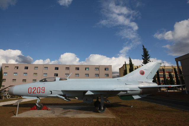 In this image taken on December 8, 2012 an old Soviet-era Chinese-produced Mig-21 aircraft is parked at Albania's Armed Forces musum in capital Tirana. The Albanian  Defense Ministry says the 40 Soviet or Chinese planes and helicopters for sale include six propeller-driven Yak-18s, Mig-15, -17, -19 and -21 jets and four Mil Mi-4 transport helicopters. They date mostly to the 1950s, and have not been used for years. (Photo by AP Photo)