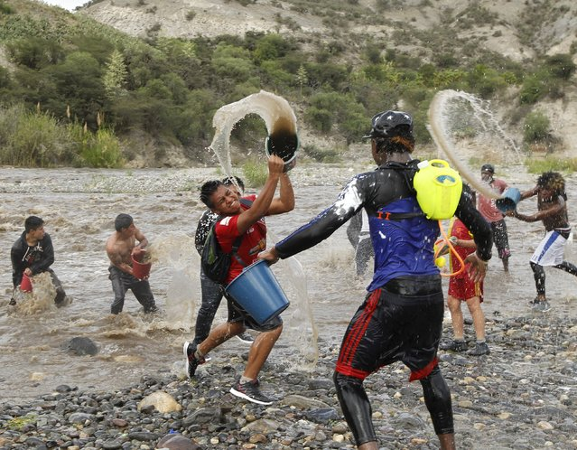 Revellers celebrate with water at the Chota river during a carnival festivity in Coangue, February 8, 2016. (Photo by Guillermo Granja/Reuters)