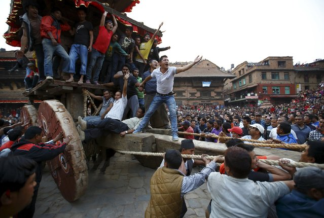 The chariot of God Bhairab is pulled through the city centre of Bhaktapur near Kathmandu during the Bisket festival April 10, 2015. (Photo by Navesh Chitrakar/Reuters)