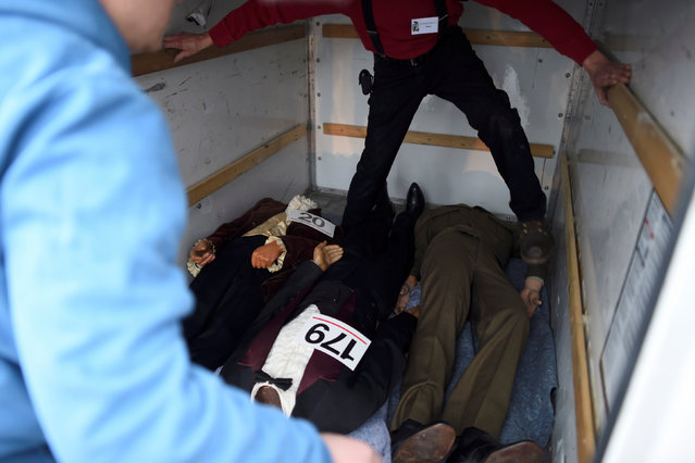 Workers place wax figures of Presidents Dwight D. Eisenhower, John Quincy Adams, and Woodrow Wilson into a truck after they were purchased from an auction of the Hall of Presidents Museum, which closed in November, in Gettysburg, Pennsylvania, U.S. January 14, 2017. (Photo by Mark Makela/Reuters)
