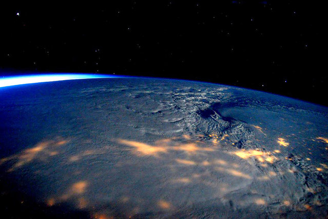 This image made available by NASA via Twitter posted on Saturday, January 23, 2016, by space station commander Scott Kelly, shows a view from the International Space Station of a storm passing over the United States. A blizzard with hurricane-force winds brought much of the East Coast to a standstill Saturday, dumping snow, stranding travelers and shutting down the nation's capital and its largest city. (Photo by Scott Kelly/NASA via AP Photo)
