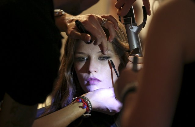 A model has makeup applied backstage of Etro Autumn/Winter 2016 women's collection during Milan Fashion Week, Italy, February 26, 2016. (Photo by Stefano Rellandini/Reuters)