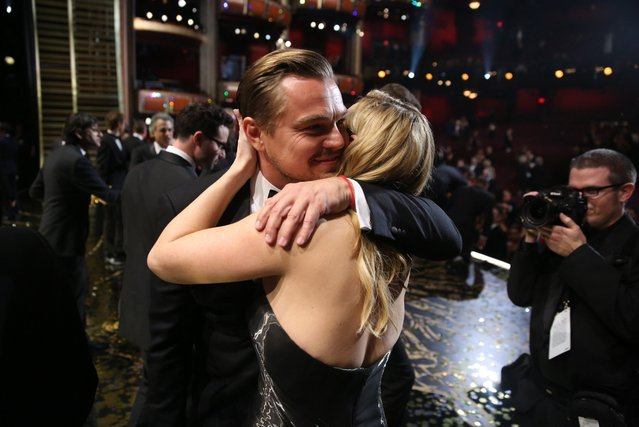 """Leonardo DiCaprio, winner of the award for best actor in a leading role for """"The Revenant"""", left, embraces Kate Winslet backstage at the Oscars on Sunday, February 28, 2016, at the Dolby Theatre in Los Angeles. (Photo by Matt Sayles/Invision/AP Photo)"""