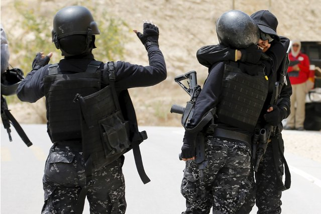 Members of the Jordanian police women's team celebrate after competing in the 7th Annual Warrior Competition at the King Abdullah Special Operations Training Center in Amman April 22, 2015. (Photo by Muhammad Hamed/Reuters)