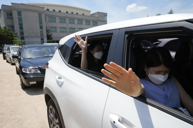 Christians inside their car pray during a drive-in worship service amid measures to help prevent the spread of the coronavirus at the Songgok high school in Seoul, South Korea, Sunday, July 25, 2021. (Photo by Ahn Young-joon/AP Photo)