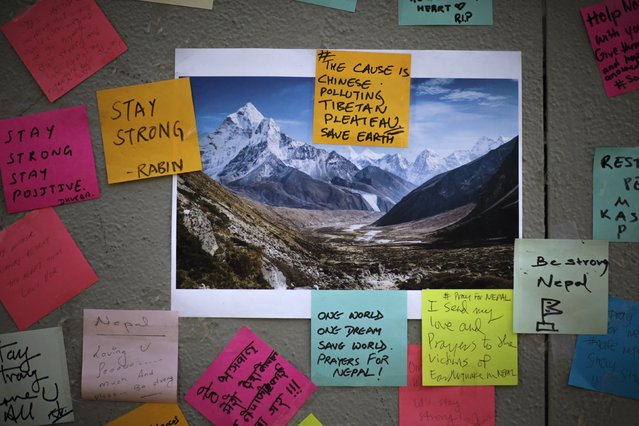 Post-it messages are seen on a wall at a makeshift memorial at the borough of Queens in New York, for the victims of Saturday's earthquake in Nepal April 29, 2015. (Photo by Eduardo Munoz/Reuters)