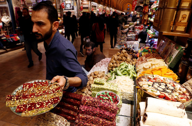 A vendor offers traditional Turkish sweets to tourists at the Spice market, also known as the Egyptian Bazaar, in Istanbul, Turkey on January 25, 2019. (Photo by Murad Sezer/Reuters)