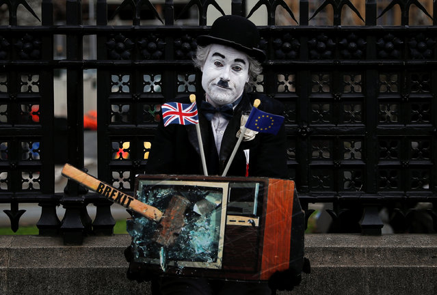 A performer is seen outside the Houses of Parliament, in London, Britain, March 27, 2019. (Photo by Alkis Konstantinidis/Reuters)