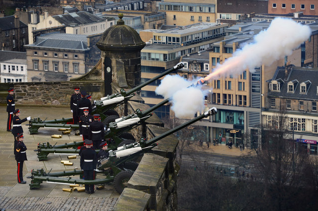 Gunners from 105th Regiment Royal Artillery  fire a 21-Gun Royal Salute at Edinburgh Castle on on February 6, 2014 in Edinburgh, United Kingdom.The 21-Gun Royal Salute was fired to commemorate the Accession to the throne of Her Majesty The Queen. (Photo by Jeff J. Mitchell/Getty Images)
