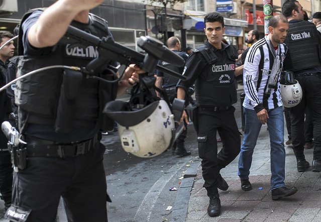 Turkish riot police officers arrest a demonstrator, right, during clashes in Istanbul, Turkey, Friday, May 1, 2015. (Photo by Emrah Gurel/AP Photo)