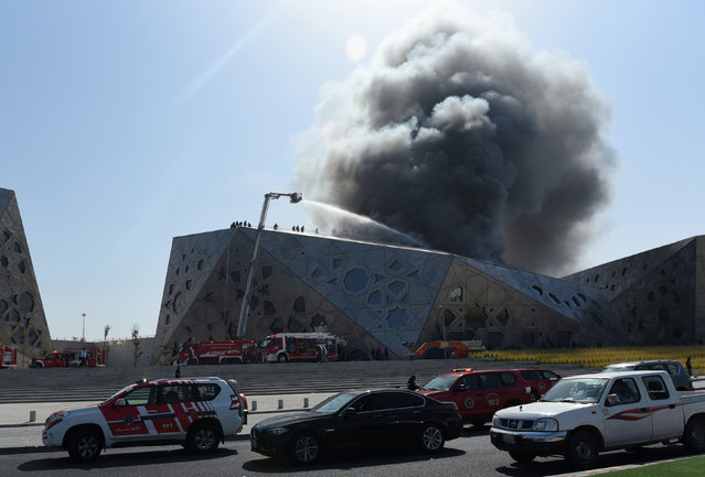 Firefighters work to contain a large fire at Jaber Al Ahmad Cultural Centre in Kuwait City, Kuwait February 6, 2017. (Photo by Stephanie McGehee/Reuters)