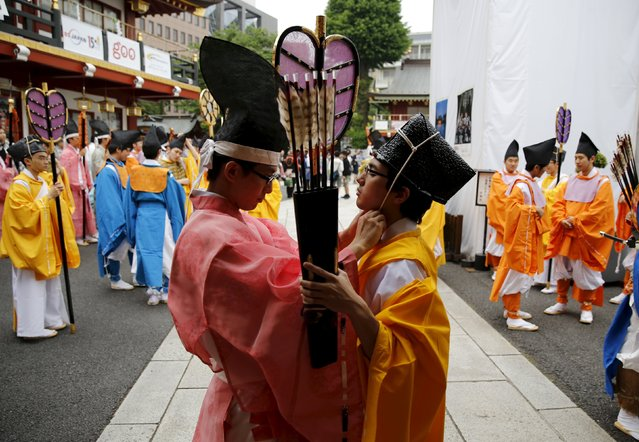 Shinto studies specialty students in traditional costumes prepare before a ritual for the Kanda festival at the Kanda-Myojin shrine in Tokyo May 9, 2015. (Photo by Toru Hanai/Reuters)