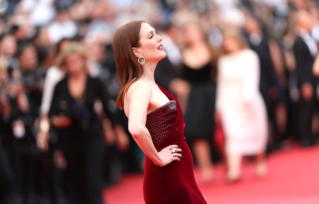 "Actress Julianne Moore poses for photographers on the red carpet for the screening of the film ""Mad Max: Fury Road"" at the 68th international film festival, Cannes, southern France, Thursday, May 14, 2015. (Photo by Lionel Cironneau/AP Photo)"
