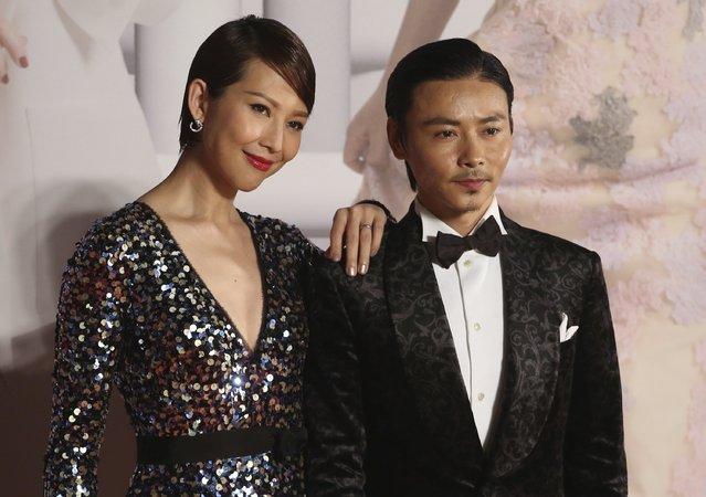 Chinese actor Zhang Jin and Hong Kong actress wife Ada Choi pose on the red carpet at the Hong Kong Film Awards in Hong Kong, China April 3, 2016. (Photo by Reuters/Stringer)