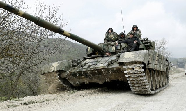 A tank of the self-defense army of Nagorno-Karabakh moves on the road near the village of Mataghis April 6, 2016. (Photo by Reuters/Staff)