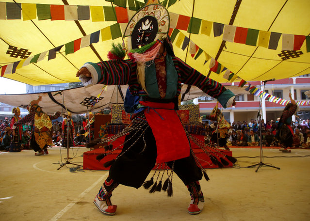 """A Tibetan man performs traditional mask dance during a function organised to mark """"Losar"""", or the Tibetan New Year, in Kathmandu, Nepal March 1, 2017. (Photo by Navesh Chitrakar/Reuters)"""