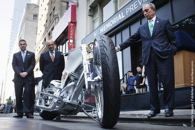 New York Mayor Michael Bloomberg stands near a custom made World Trade Center inspired motorcycle in front of the 9/11 Memorial Preview Site