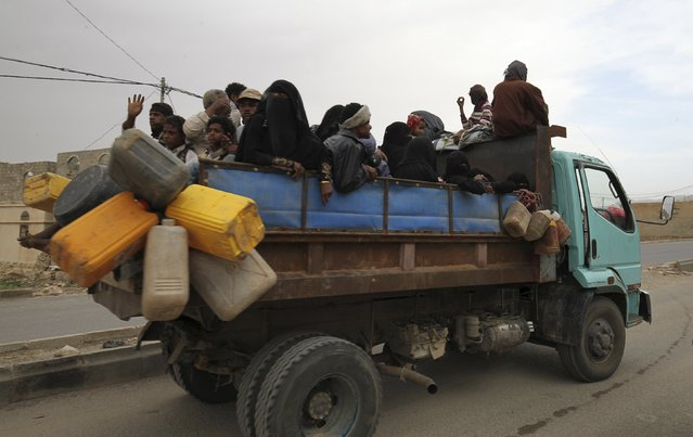 Internally displaced people ride on the back of a truck as they flee in the district of Khamir of Yemen's northwestern province of Amran May 9, 2015. (Photo by Mohamed al-Sayaghi/Reuters)