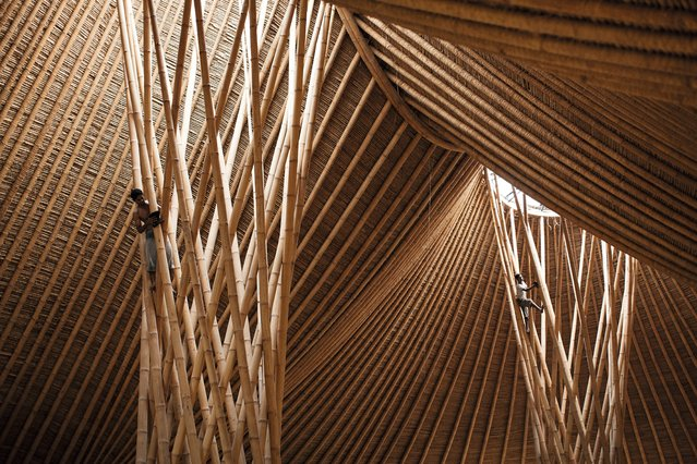 Three mountain, Green village, Bali, by Jörg Stamm. This inventive bamboo structure – designed with a nod to nearby volcanoes – houses workspace for 300 people. (Photo by Mark Magidson/The Guardian)
