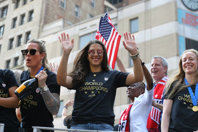 Alex Morgan acknowledges the crowds as the U.S. women's soccer team is celebrated with a parade along the Canyon of Heroes, Wednesday, July 10, 2019, in New York. (Photo by Gordon Donovan/Yahoo News)