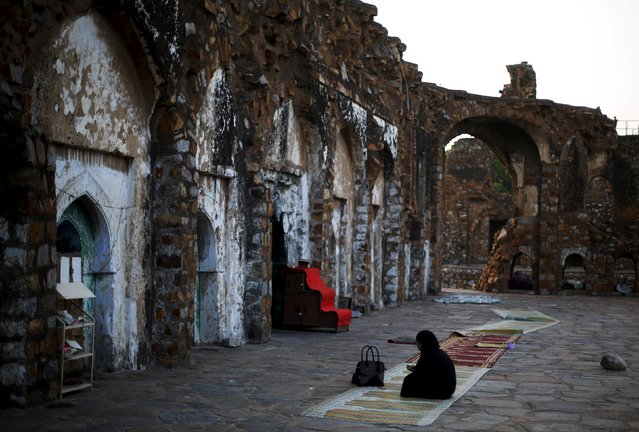 A Muslim woman prays before having her Iftar (breaking of fast) meal during the holy month of Ramadan at the ruins of the Feroz Shah Kotla mosque in New Delhi, India, June 28, 2015. (Photo by Adnan Abidi/Reuters)