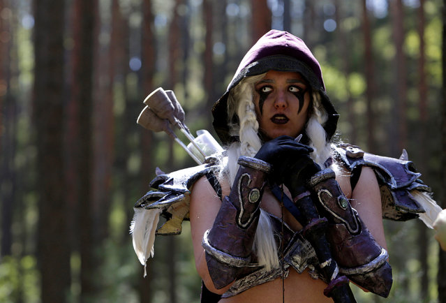 """A woman dressed as a character from the computer game """"World of Warcraft"""" stands in a forest near the village of Sosnova, Czech Republic, April 30, 2016. (Photo by David W. Cerny/Reuters)"""