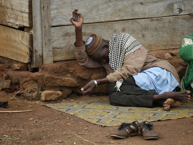 An internally displaced Muslim man lies in front of a house in the town of Boda April 15, 2014. (Photo by Goran Tomasevic/Reuters)