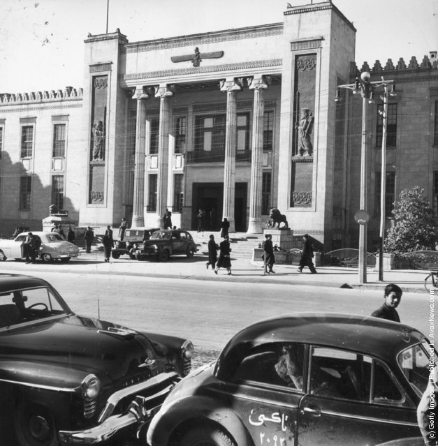 1955:  The Melli bank which is the centre of foreign commerce in Teheran, Persia. The architecture is modern though the relief figures on the front are of ancient Persians
