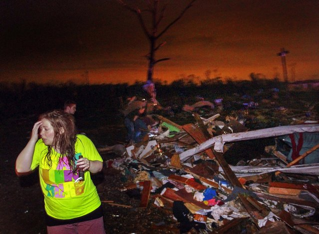 Sunday night, Lauren Watts searches for her dog in Mayflower, Arkansas., after a tornado struck the town. (Photo by Benjamin Krain/The Arkansas Democrat-Gazette)